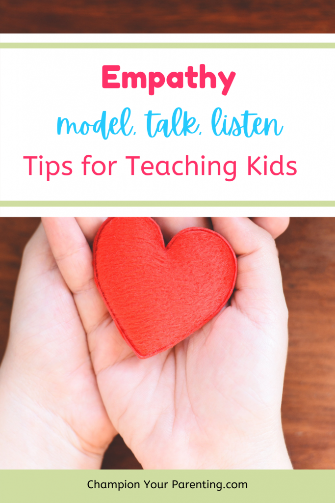 hands holding heart- text overlay, empathy, tips for teaching kids