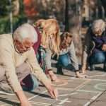 Family making hopscotch board, fun family activities