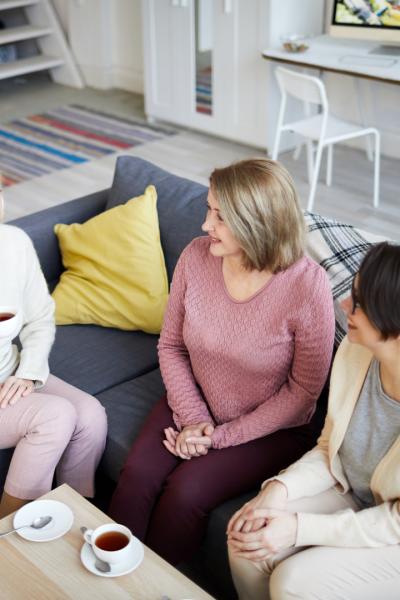 3 women on couch talking